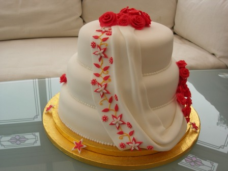 Drape and flowers wedding cake