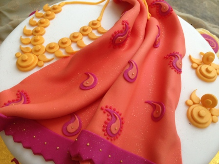 Close-up of Saree & jewellery 50th cake